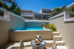 Porto Platanias Junior Suite with private pool exterior image depicting the veranda with the pool